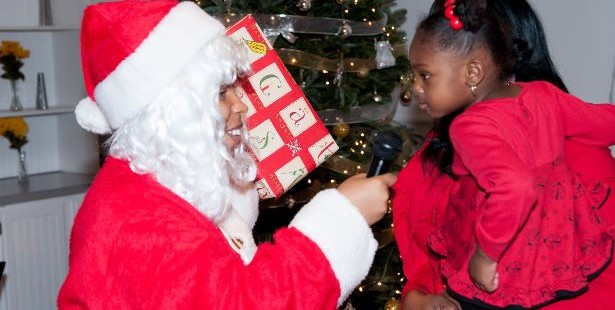 Baby receiving gift from Santa